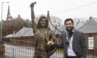 Justice secretary Humza Yousaf at the Bon Scott statue in Kirriemuir.