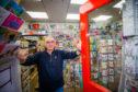 Ian Morgan at his newsagents in Bridgend