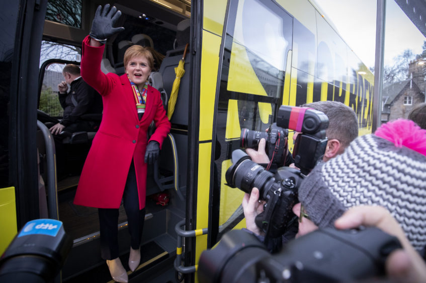 SNP leader Nicola Sturgeon boards the party's campaign bus outside the Scottish Parliament, Edinburgh, on the last day of the General Election campaign trail.