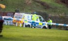 Police cordon off an area of the Newburgh coast following the discovery of a body.