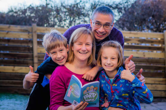 Jill Young at home with her family: husband John and 11 year old twins Fraser and Hayley. Picture: Steve MacDougall.
