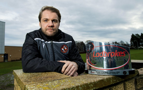 Robbie Neilson with his award.