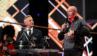 Former rugby player Gareth Thomas brings the Sports Personality of the Year Award to the stage during the BBC Sports Personality of the Year 2019 at the P&J Live, Aberdeen.