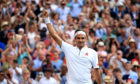 Roger Federer celebrates victory following his match against Rafael Nadal at Wimbledon
