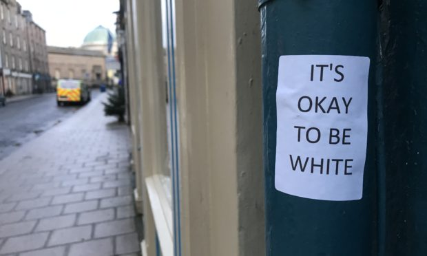 "Stickers reading ""Its okay to be white"" have appeared around Perth."