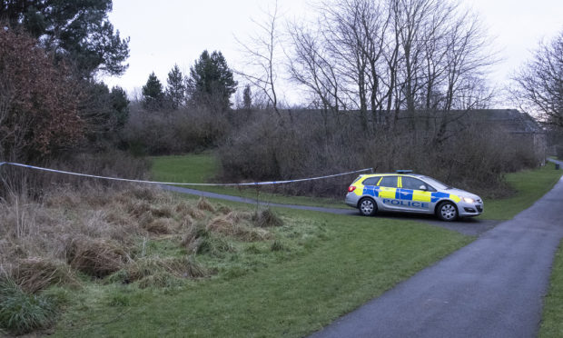 Police at the cordoned off area at the end of Dens Road, Arbroath.