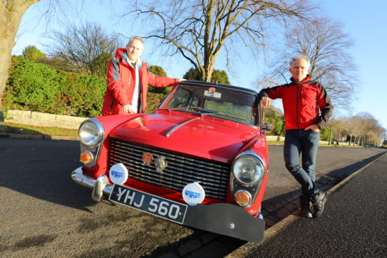 Colin, left, and Richard Levin beside their Austin A40 in which they will tackle the Monte Carlo Classique,