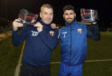 Stewart Petrie and Andrew Steeves with their recent manager and player of the month awards.