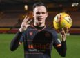 Lawrence Shankland with the match ball after his hat-trick.
