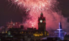 Fireworks are launched from Edinburgh Castle at midnight during the Hogmanay New Year celebrations.