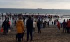 Some of the Kirkcaldy loony dookers head for the sea.